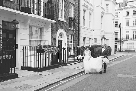 Bride and groom outside in the street