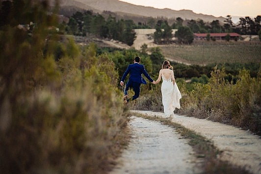 Shane and Charlie walking outside on their wedding day