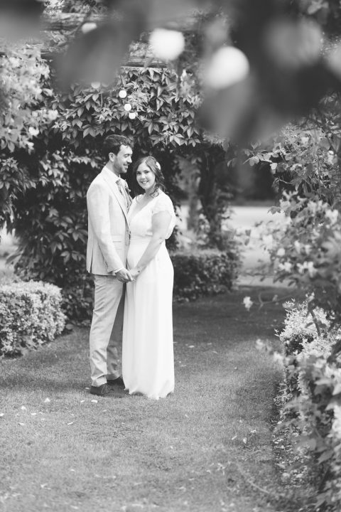 Couple on their wedding day outside in the garden