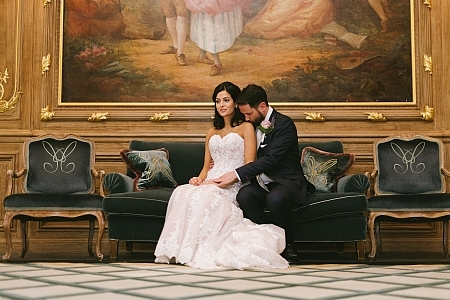 Bride and groom sitting on the couch
